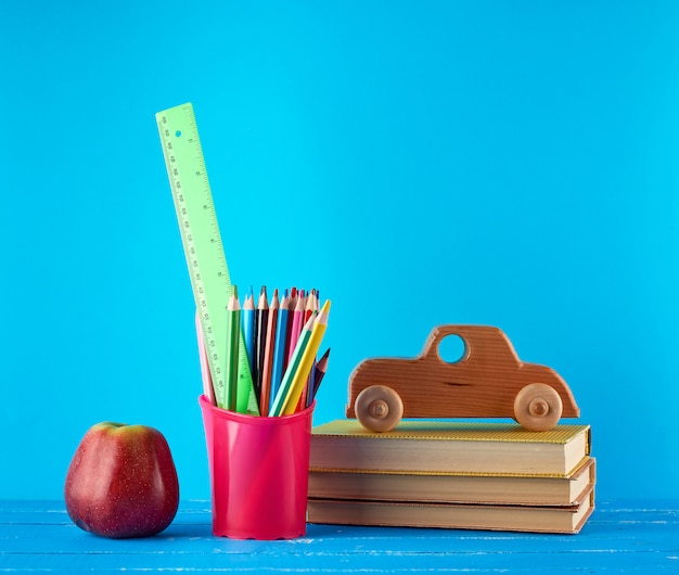 Background back to school with children's stationery pencils