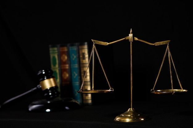 Background of balance scale, hammer, law books for justice and fairness in society because people wants the most. concept of judgement education to prevent crime