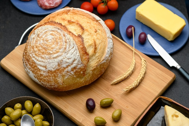 Background balanced blue bread breakfast breakfast table brown butter cherry tomatoes close