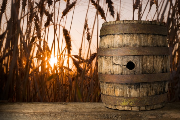 Background of barrel and worn old table of a wheat background