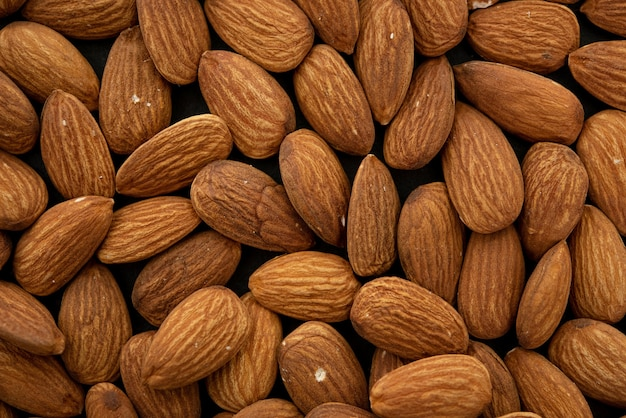 Background of big raw peeled almonds. top view