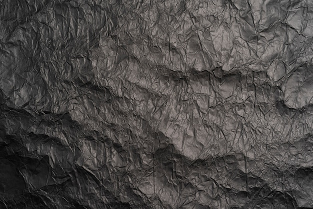 Фон черный мятой бумаги текстура