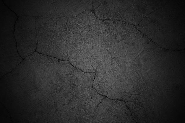 背景の黒い壁、暗いテクスチャのコンクリート表面