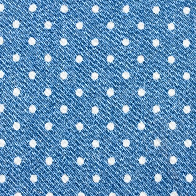 Background of blue jeans with white polka dot pattern