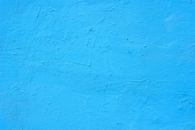 Background of a blue painted cement wall, rough cast of cement and concrete wall texture