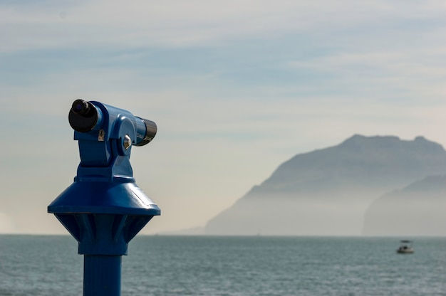 Background of a blue panoramic touristic telescope overlooking the mediterranean sea
