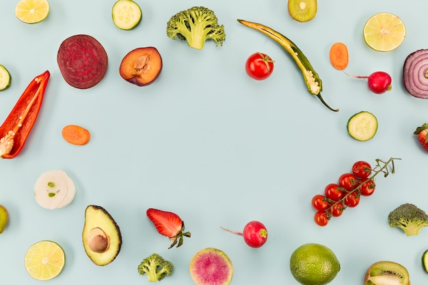 Background blue with veggies and fruit copy space