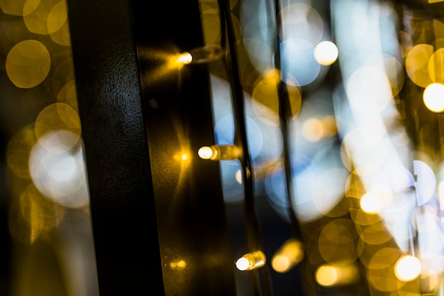 Background of blurred glowing christmas golden lights