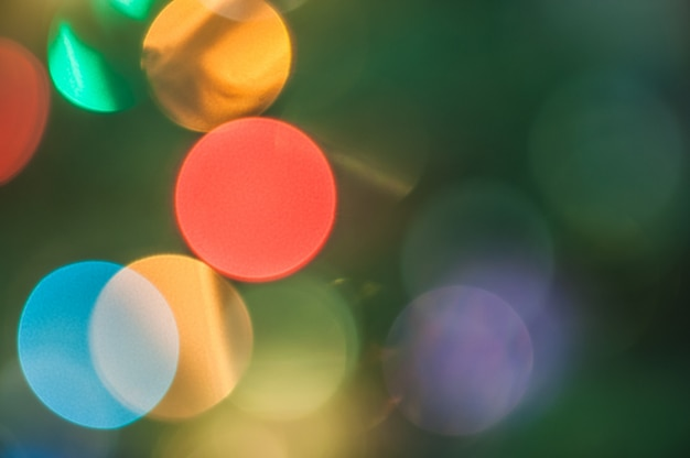 Background bokeh colored bright new year and christmas circles.