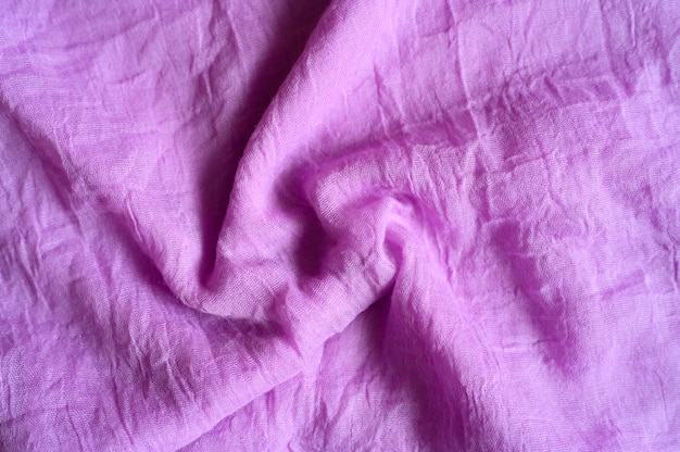 Background of bright pink cotton wrinkled fabric cloth