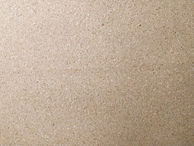 Background brown color particle board texture close up