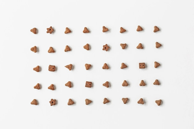 Background of cat dry food. minimalistic white flat. natural backdrop