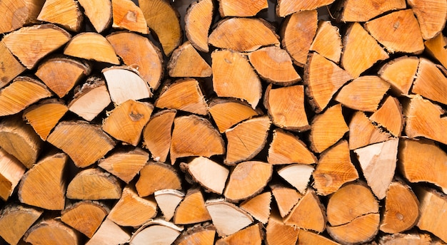 Background of chopped firewood closeup