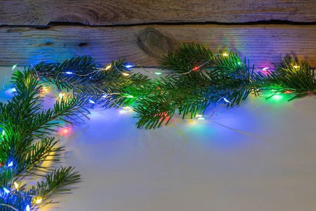 Background christmas decoratio-christmas lights with decoration on a wooden background