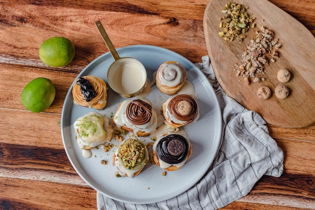 Background of cinnamon rolls with chocolate, pistachio, lemon, peanut butter and classic.