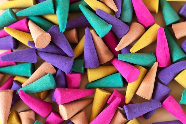 Background of colorful aroma incense cones top view