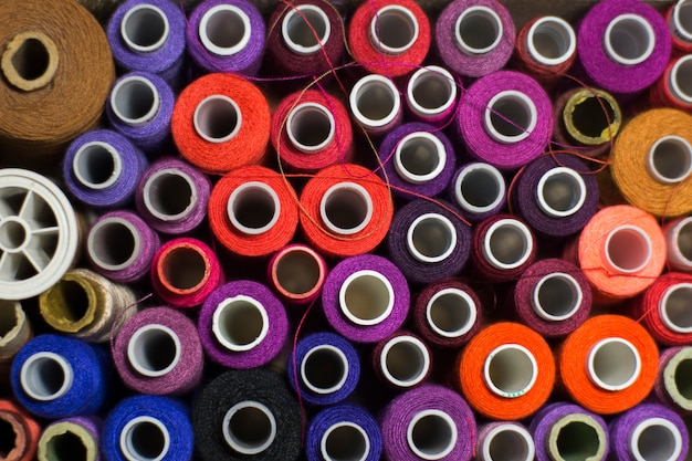 Background of colorful spools of thread.  top view