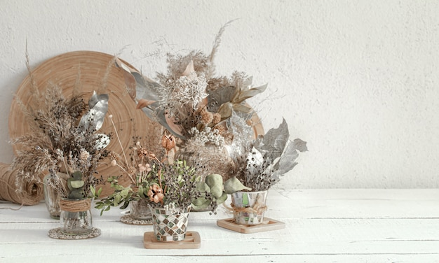 Background composition with many different dried flowers in vases