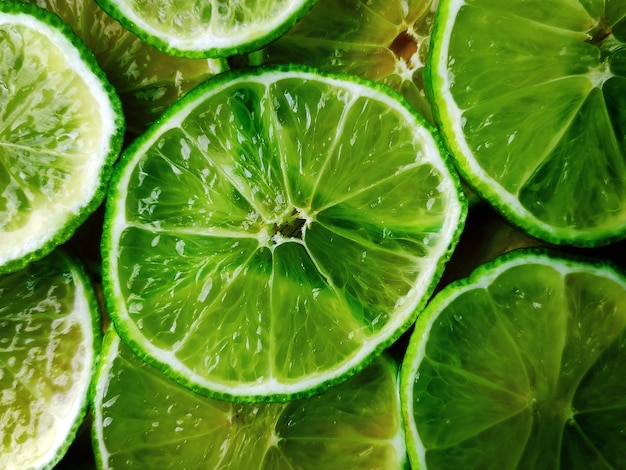 Background consisting of lime slices.