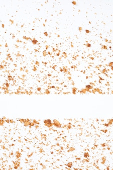 Background of cookie scraps isolated on white background.