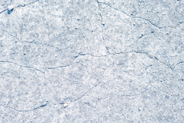 Background of cracked plaster grey walls