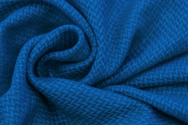 Background of crumpled blue cotton fabric, trend color of year 2020 classic blue.