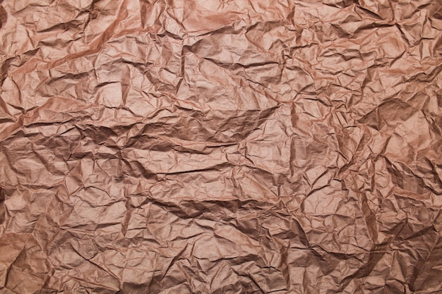 Background crumpled paper gloss brown wallpaper texture top view clear