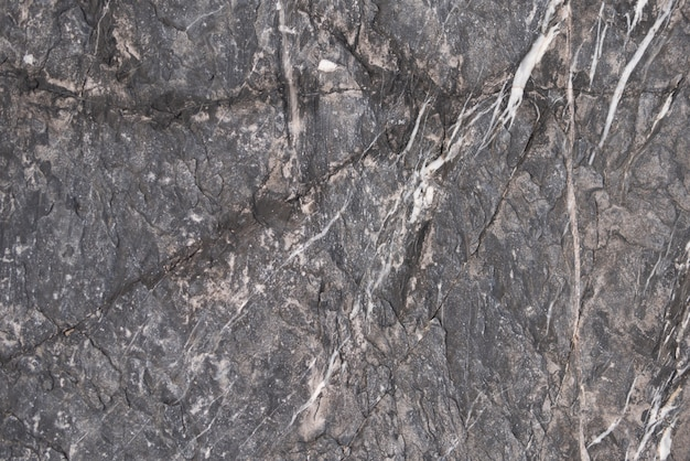 Background of dark gray stone with broken