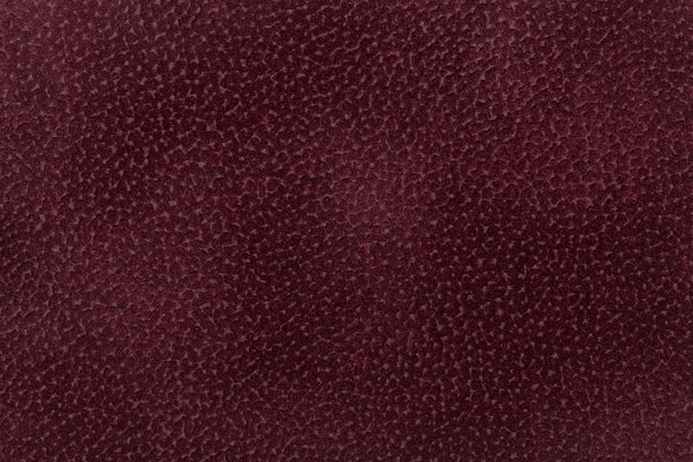 Background of dark red fabric decorated with coat animal