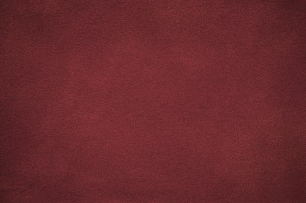 Background of dark red suede fabric