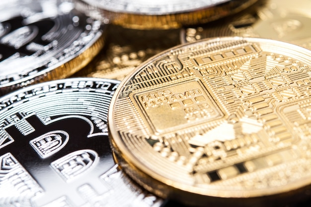 Background of different coins. bitcoin symbol.