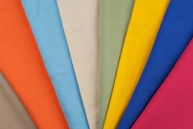 Background of different colors of fabric material for sewing