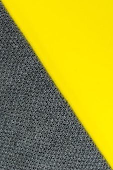 Background divided diagonally into two colors: illuminating yellow and ultimate gray.