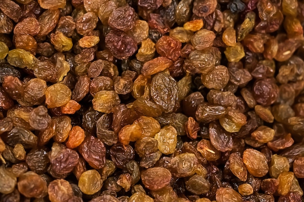 Background of dried raisins. vegetarian sweets for diet food.