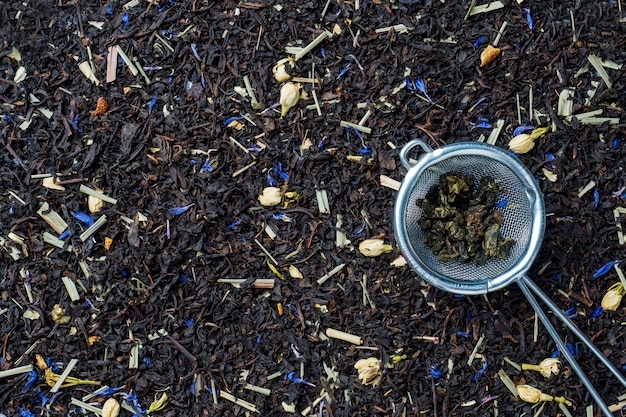 Background of dry tea leaves and flowers.