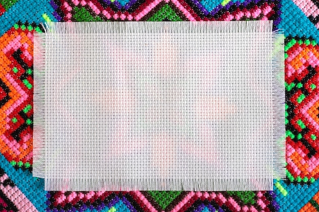 Background embroidered cross on the canvas in the form of geometric patterns