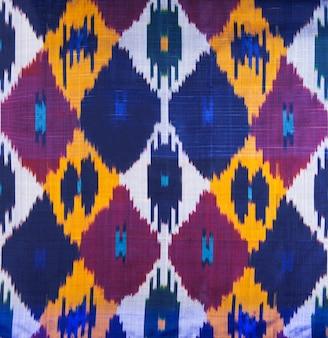 Фоновые ткани и текстиль с красочным восточным декоративным орнаментом и узором
