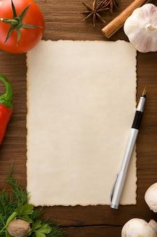 나무 테이블에 요리법과 향신료를 위한 배경