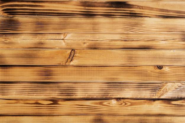 Фон для надписей - обгоревшее дерево со сбитыми рельсами