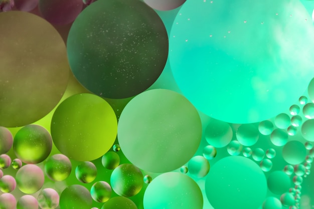 Background in the form of multicolored circles. made of oil drops.