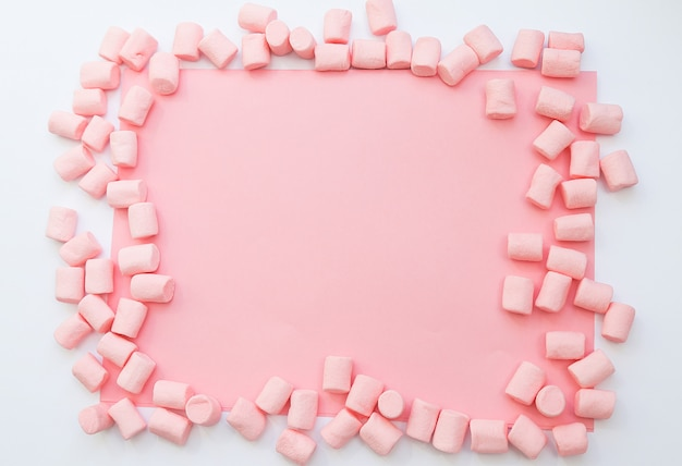 Background frame made of marshmallows . the concept of childhood