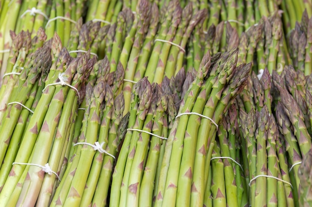 Background of fresh green asparagus vegetables in market.