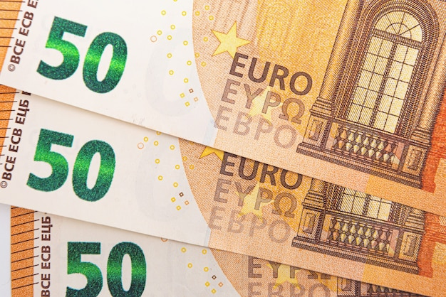 Background from 50 euro banknotes, euro banknote as part of the economic and trading system, close-up