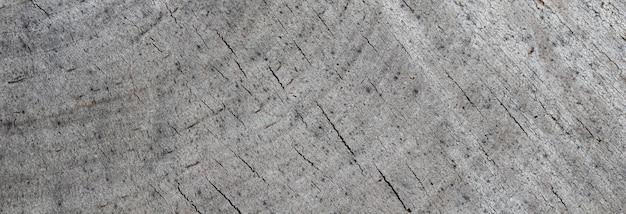 木の幹の断面からの背景古い風化したリングからの抽象的なテクスチャ
