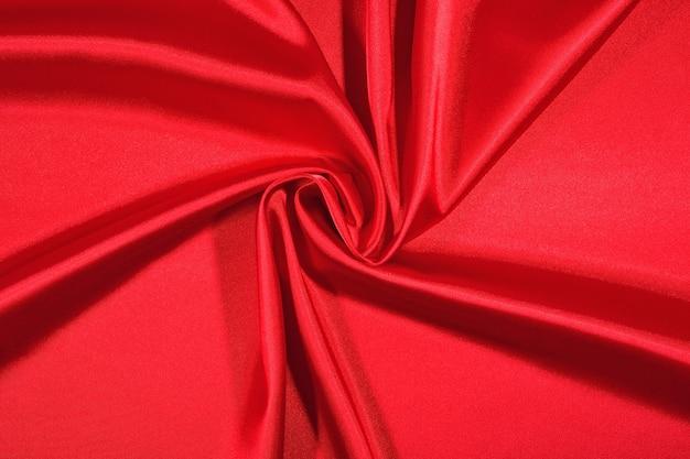 Фон из красной атласной ткани