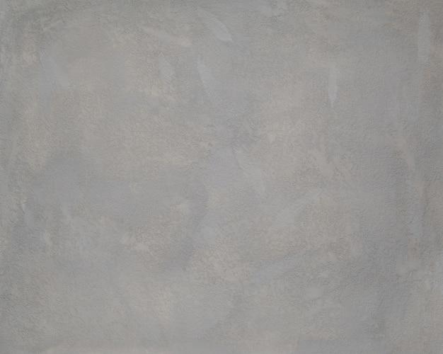 회색 색상의 질감된 석고에서 배경입니다. 예술 배경
