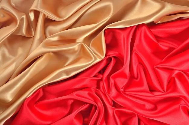 Фон из золотой и красной атласной ткани