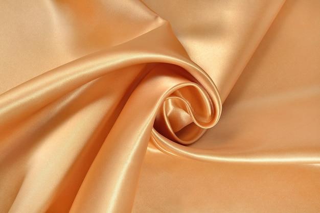 Фон из золотой атласной ткани