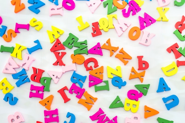 Background from multicolored english letters. letters on white.
