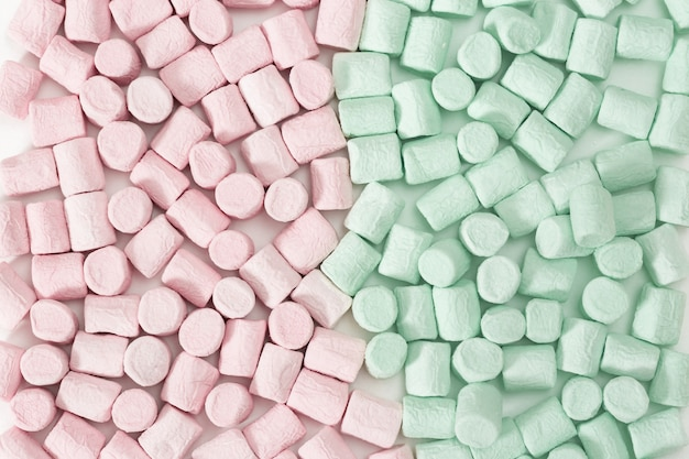 Background from pink and green and pink mini marshmallow.